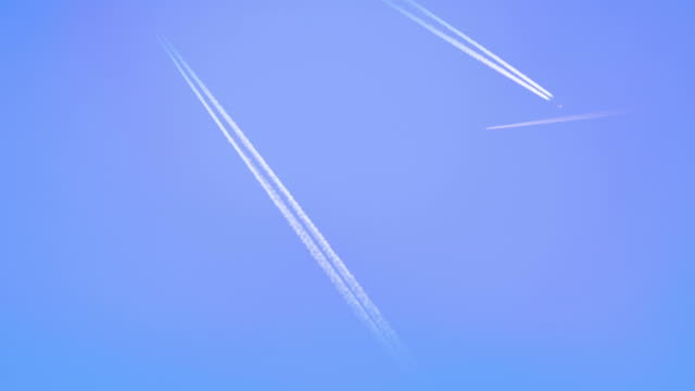 Airplanes with trails flying over screen video