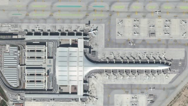 airport aerial top view with the aircraft, the terminal building and runway - airports stock videos & royalty-free footage