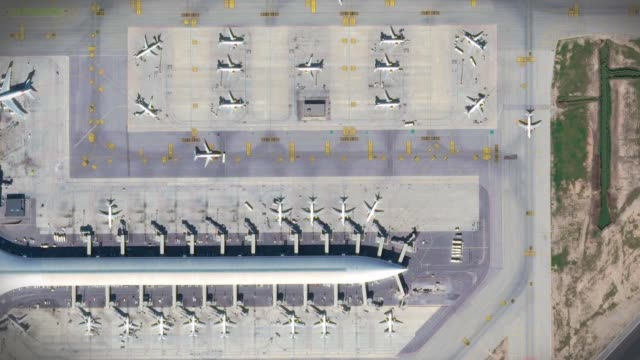 Airport aerial top view with the aircraft, the terminal building and runway Barcelona Airport top view with the aircraft, the terminal building and runway airport runway stock videos & royalty-free footage