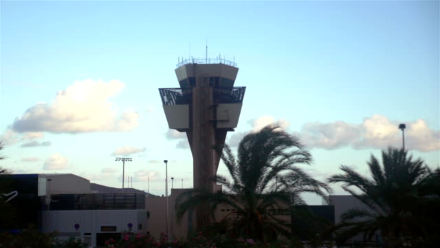 Airport control tower from car in slow motion 180fps video