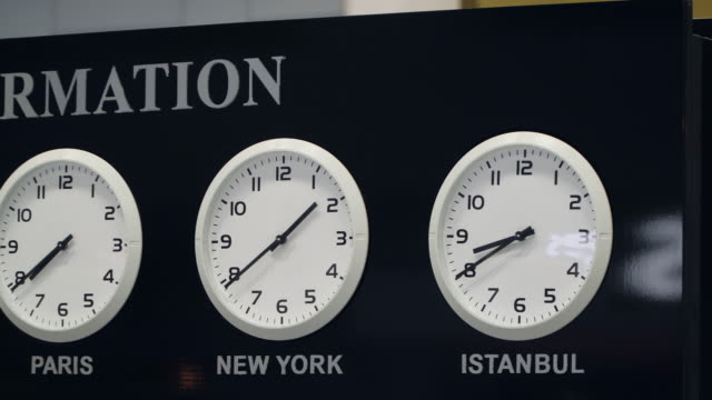 Airport information desk with time zone clocks Airport information desk with time zone clocks time zone stock videos & royalty-free footage