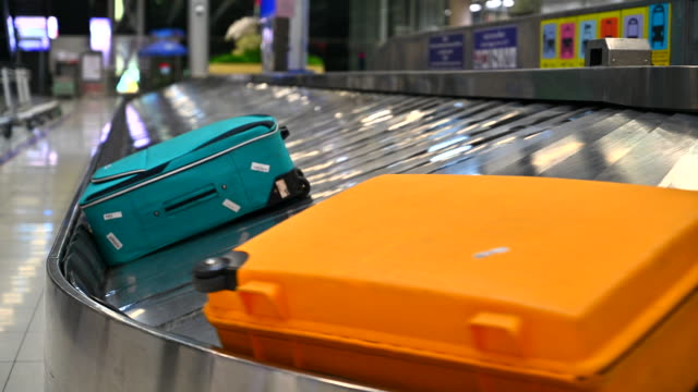 Airport luggage cart stand beside  baggage on belt Passenger Terminal