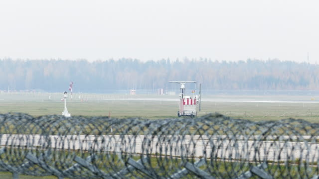 Airport runway behind security fence