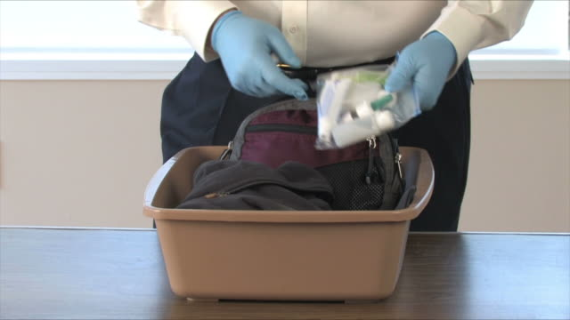 Airport Security Searches Carryon Items video