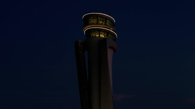 Airport Tower at Sunset with Moon Aerial View