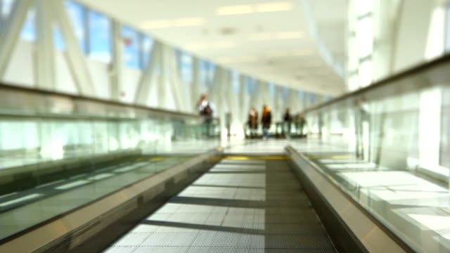 Airport Travelers On Moving Walkway Tilt Shift video