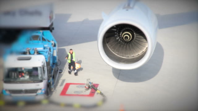 Airport airplane is refueled refueling stock videos & royalty-free footage
