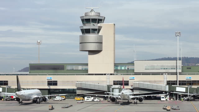 Airport with aircraft and radar tower Airport with aircraft and radar tower airfield stock videos & royalty-free footage