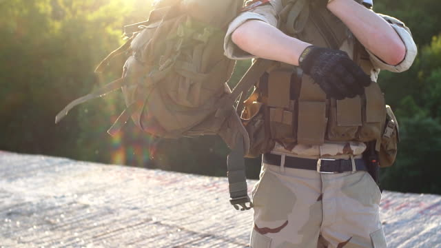 Airsoft Game. Man in military uniform. Slow motion video