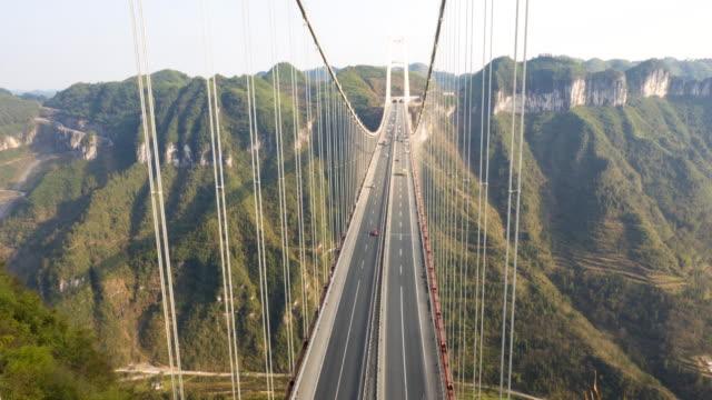 Aizhai Bridge aerial view Aizhai Bridge 矮寨特大桥 Jishou,Hunan,China ,1102 ft/ 336 meters high,3858 ft/ 1176 meters span,Aizhai is the world's highest and longest tunnel to tunnel bridge suspension bridge stock videos & royalty-free footage