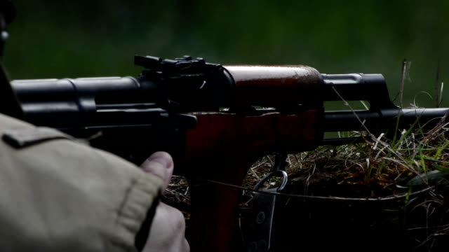 Ak 47 receiver close up while firing video