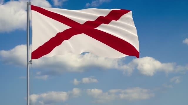 alabama state flag in wind against cloudy sky - alabama filmów i materiałów b-roll