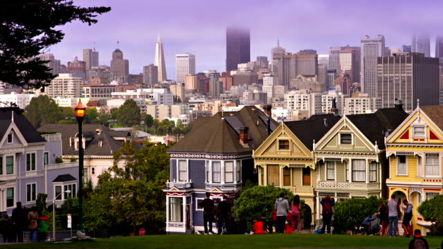 alamo square and business district background, san francisco - victorian architecture stock videos & royalty-free footage