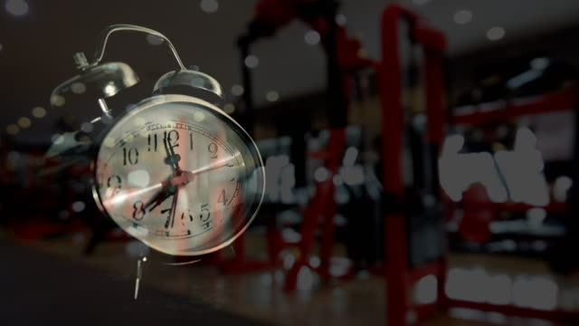 Alarm clock and Blurred motion of Fitness Exercising background video