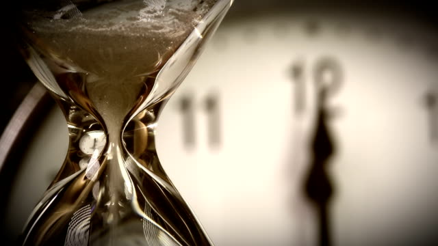 Alarm clock and Hourglass - 12.00 clock