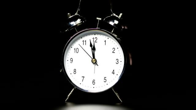 Alarm clock on black background video