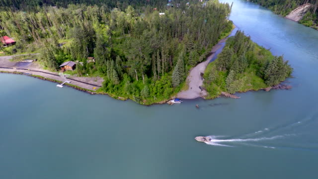 Alaska 4K Drone overhead shot of world record King Salmon fishing Kenai River with powerboat going around corner video