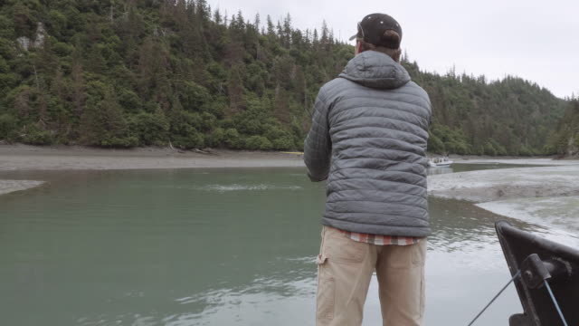 uhd 4k: alaska fisherman fishing with a pole - fishing video stock e b–roll