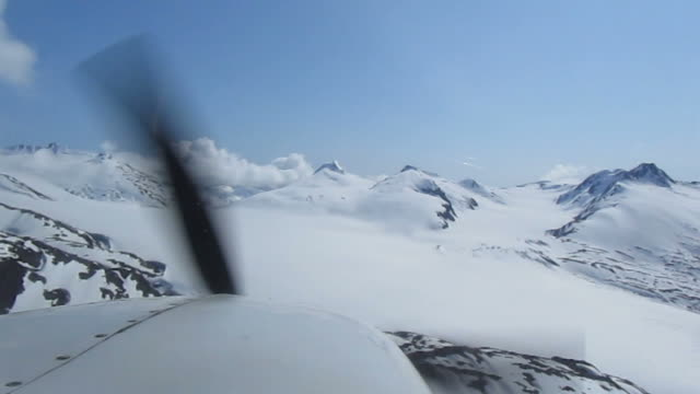 Alaska view with sea plane Alaska view with sea plane propeller airplane stock videos & royalty-free footage