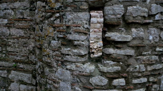 Albania, Butrint. Window gap at the Apse wall. Pan video