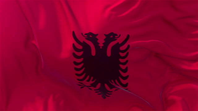 vídeos de stock e filmes b-roll de albania flag in slow motion classic flag smooth blowing in the wind on a windy day rising sun 4k continuous seamless loop background - democracy illustration
