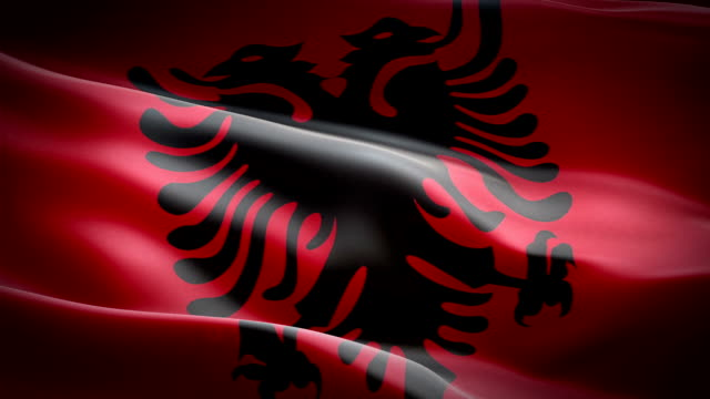 albania waving flag. national 3d albanian flag waving. sign of albania seamless loop animation. albanian flag hd resolution background. albania flag closeup 1080p full hd video for presentation - kiss стоковые видео и кадры b-roll