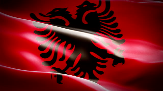 albanian flag closeup 1080p full hd 1920x1080 footage video waving in wind. national 3d albanian flag waving. sign of albania seamless loop animation. albanian flag hd resolution background 1080p - kiss стоковые видео и кадры b-roll