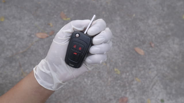 alcohol spray and wipe car key - igiene video stock e b–roll