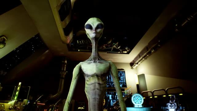 alien pressar nycklarna på sci-fi hologaphic skärmen. realistisk rörelse bakgrunden. - rymdvarelse bildbanksvideor och videomaterial från bakom kulisserna