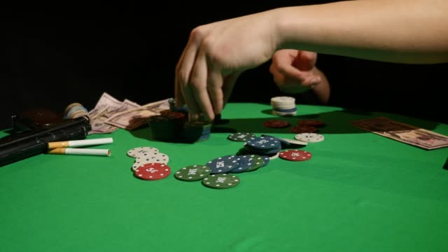 all in. close-up of man doing all in while sitting at the poker table - feltro video stock e b–roll