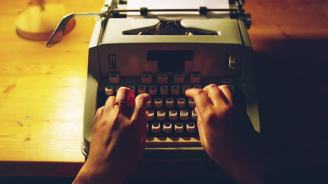 All she needs are keys 4k video footage of a woman using a typewriter late at night typewriter stock videos & royalty-free footage