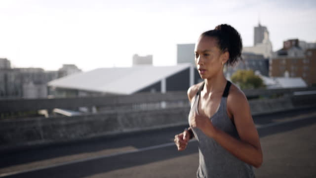 All your efforts matter 4k video footage of a sporty young woman checking her watch while running in the city checking the time stock videos & royalty-free footage