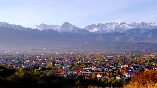 Almaty Sunrise Time Lapse 4k Time lapse panoramic view of the upper part of Almaty city on the background of mountains in autumn season; golden fall, beauty and greatness of Kazakhstan concept kazakhstan stock videos & royalty-free footage