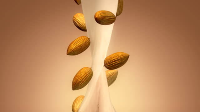 vídeos de stock e filmes b-roll de almond milk flowing - amendoas