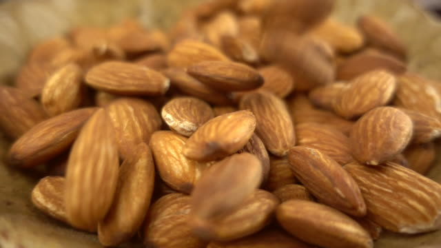 almonds falling in super slow motion - noci video stock e b–roll