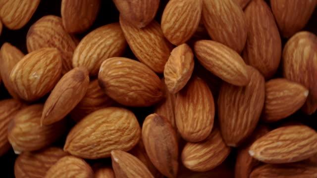 vídeos de stock e filmes b-roll de almonds in the air - amendoas