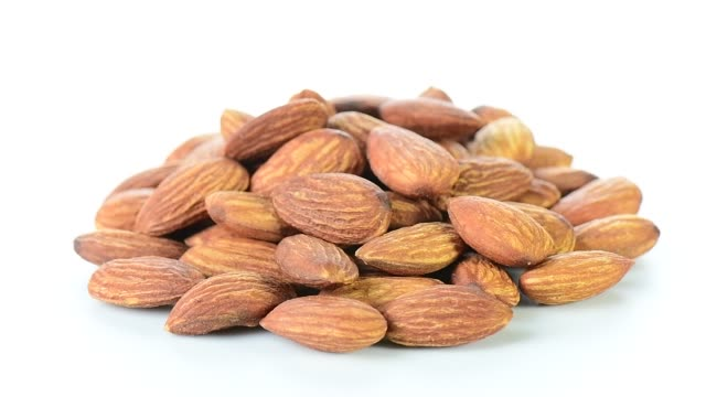 almonds rotating - mucchio video stock e b–roll