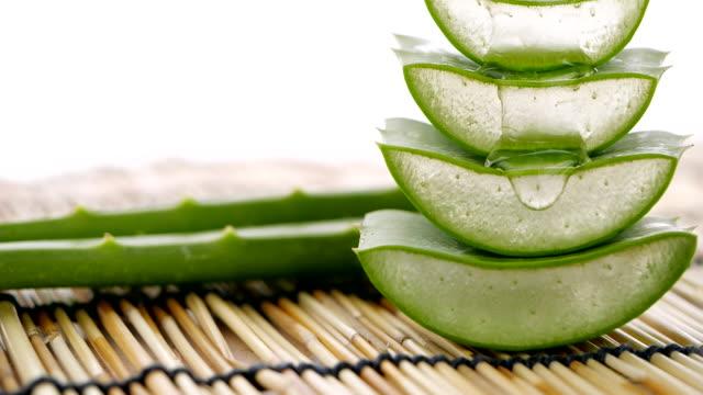 Aloe Vera leaves. Aloe Vera gel dripping in slow motion. Aloe Vera gel is very useful herbal medicine for skin care