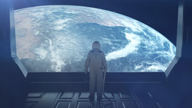 alone astronaut in futuristic space corridor, room. view of the earth. 4k - glass world video stock e b–roll