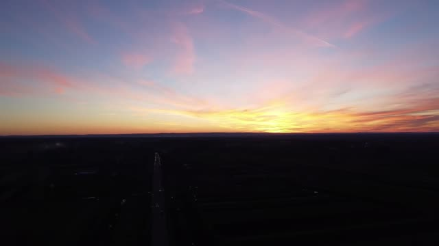 along the road sunrise aero video