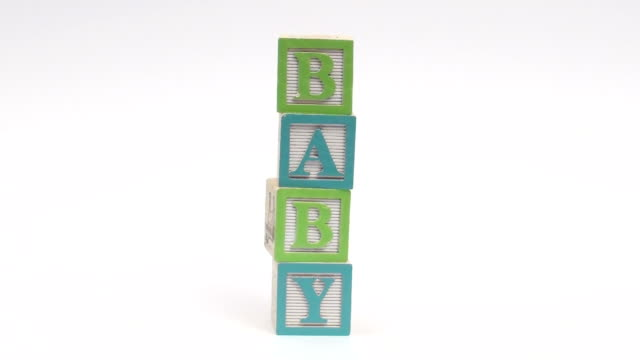 Alphabet blocks BABY - HD HD 1080i Alphabet blocks isolated against white spell out BABY block shape stock videos & royalty-free footage