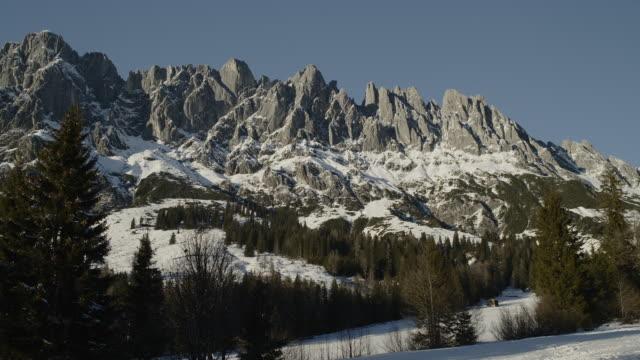 alpine landscape with the hochkönig in the evening light, hiking area, alps, mühlbach, salzburger land, austria, europe - eisklettern stock-videos und b-roll-filmmaterial
