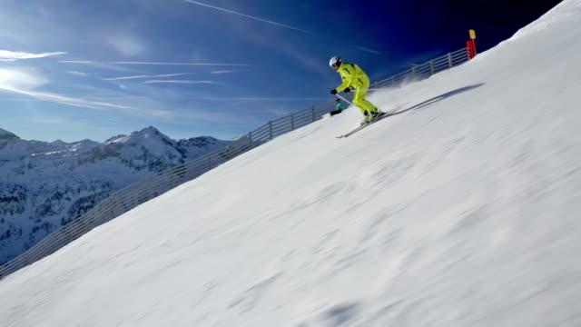 alpine skier skiing in short swings on ski piste video