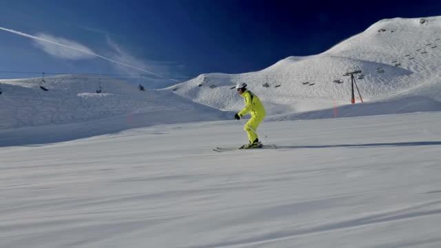 alpine skier skiing on flat ski piste video