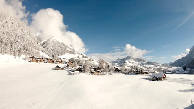 Alps in Winter Drone footage of Swiss Alps in Winter chalet stock videos & royalty-free footage