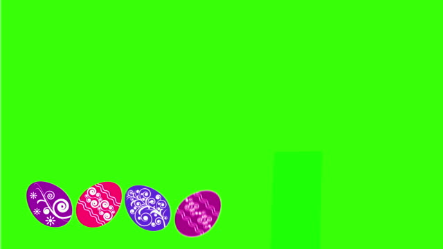 Alternate appearance of Easter eggs on a green background video