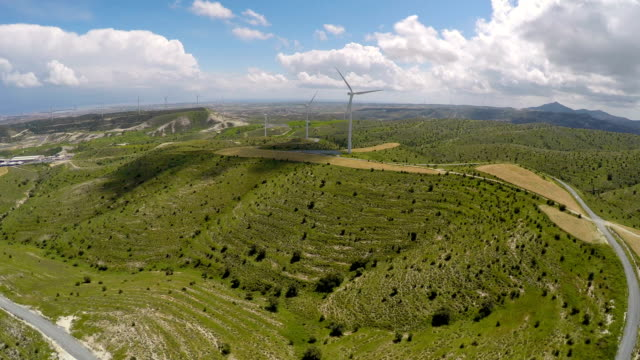 Alternative energy sources at Mediterranean, bird's-eye view of wind turbines video