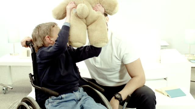 Alternative therapy for a child Child in alternative therapy because of a mental and physical disability. sociology stock videos & royalty-free footage