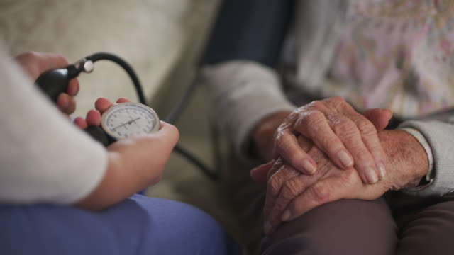 Always making sure her levels are under control 4k video footage of a healthcare worker checking a patient's blood pressure blood pressure gauge stock videos & royalty-free footage