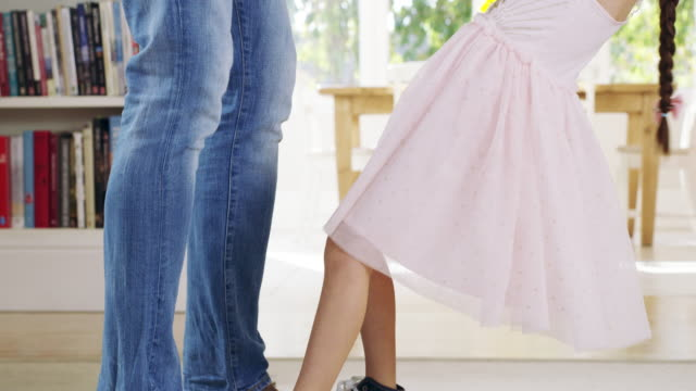 Always remember the days you danced with your father 4k video footage of an unrecognizable Dad and his daughter dancing at home princess stock videos & royalty-free footage